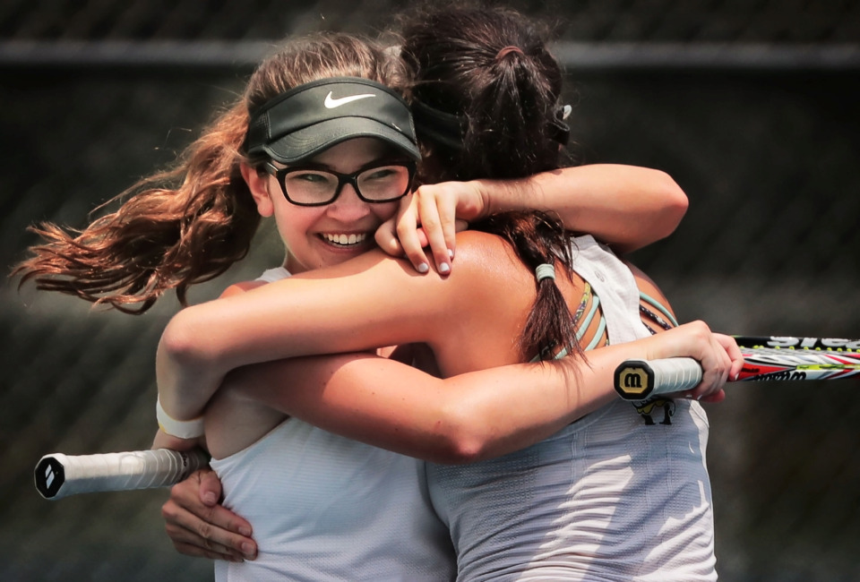 <strong>Hutchison student AC Lee (left) celebrates with doubles partner Stephanie Woodbury after winning the Div II Class AA doubles championship against teammates Anne Grinder and Grace Anne Dunavant during the finals of the Spring Fling singles and doubles tennis tournament at the Adams Tennis Complex in Murfreesboro on May 24, 2019.</strong> (Jim Weber/Daily Memphian)
