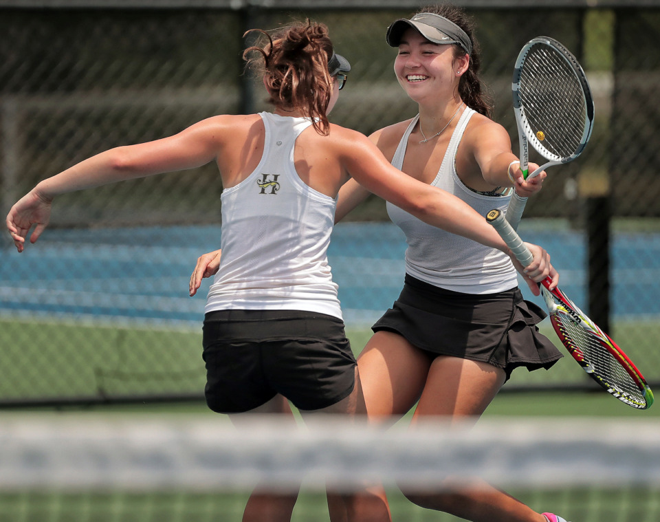 <strong>AC Lee (left) celebrates with doubles partner Stephanie Woodbury from Hutchison after winning the Div II Class AA doubles championship against teammates Anne Grinder and Grace Anne Dunavant during the finals of the Spring Fling singles and doubles tennis tournament at the Adams Tennis Complex in Murfreesboro on May 24, 2019.</strong> (Jim Weber/Daily Memphian)