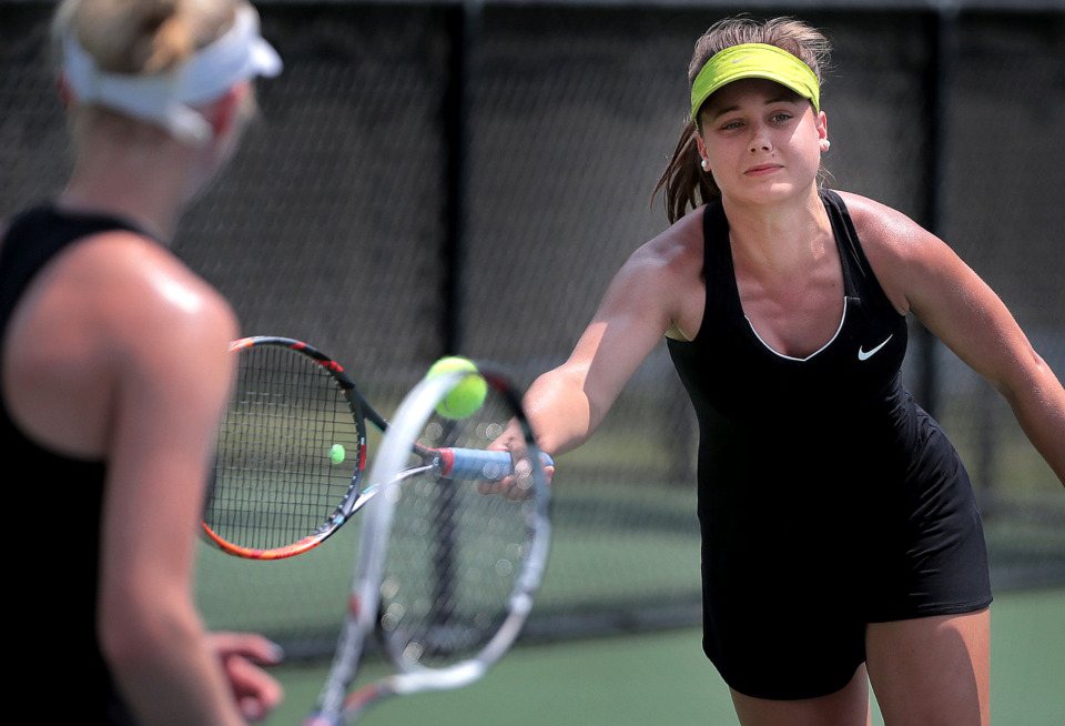 <strong>Anne Grinder (right) and Grace Anne Dunavant (left) return a volley during the Div II Class AA doubles championship against Hutchison teammates AC Lee and Stephanie Woodbury during the finals of the Spring Fling singles and doubles tennis tournament at the Adams Tennis Complex in Murfreesboro on May 24, 2019.</strong> (Jim Weber/Daily Memphian)