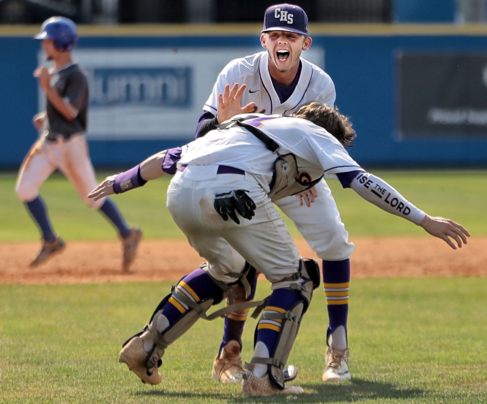 <strong>Senior Covington pitcher Ty Warmath is tackled by catcher Sterling Lomax after the final out in Covington's 11-1 win over Forrest in the Spring Fling Class AA state title game at MTSU in Murfreesboro on May 24, 2019.</strong>&nbsp;(Jim Weber/Daily Memphian)