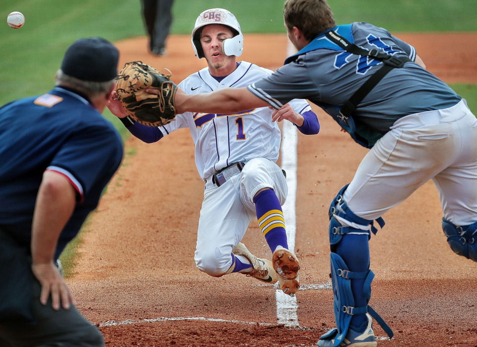 <strong>Pitcher Ty Warmath (1) slides in for the first of five Covington runs in the first inning during Covington's 11-1 win over Forrest in the Spring Fling Class AA state title game at MTSU in Murfreesboro on May 24, 2019.</strong> (Jim Weber/Daily Memphian)