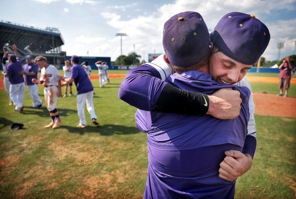 <strong>Covington pitcher Ty Warmath hugs his father, coach Brad Warmath, after the Chargers' 11-1 win over Forrest in the Spring Fling Class AA state title game at MTSU in Murfreesboro on May 24, 2019.</strong>&nbsp;(Jim Weber/Daily Memphian)