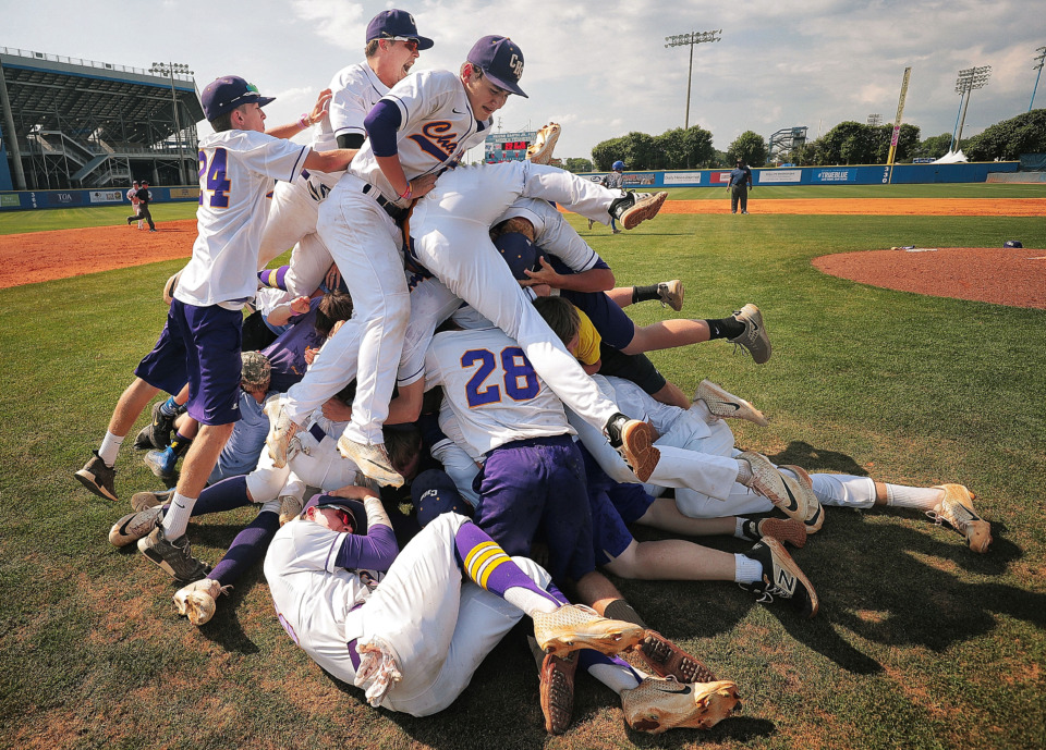 <strong>Covington players celebrate their 11-1 win over Forrest in the Spring Fling Class AA state title game at MTSU in Murfreesboro on May 24, 2019. The title is an emotional finish for a Chargers team that faced numerous hardships this season.&nbsp;</strong>(Jim Weber/Daily Memphian)