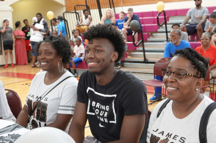 <strong>James Wiseman (with his sister Jaquarius Greer and mother Donzaleigh Artis) is honored during a pep rally Saturday at East High School.</strong> (Karen Pulfer Focht/Special to The Daily Memphian)