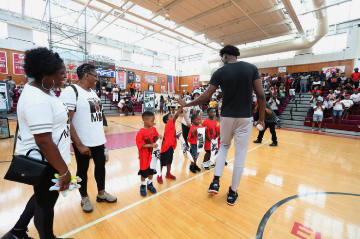 <strong>James Wiseman greets young fans during a rally in his honor Saturday at East High School.</strong> (Karen Pulfer Focht/Special to The Daily Memphian)