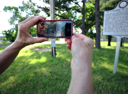 <strong>Sharon Pavelda shows a picture of the actual site where Ell Persons was lynched in 1917. The location is near the banks of the Wolf River several hundred yards to the northwest of the direction she&rsquo;s facing.</strong> (Patrick Lantrip/Daily Memphian)