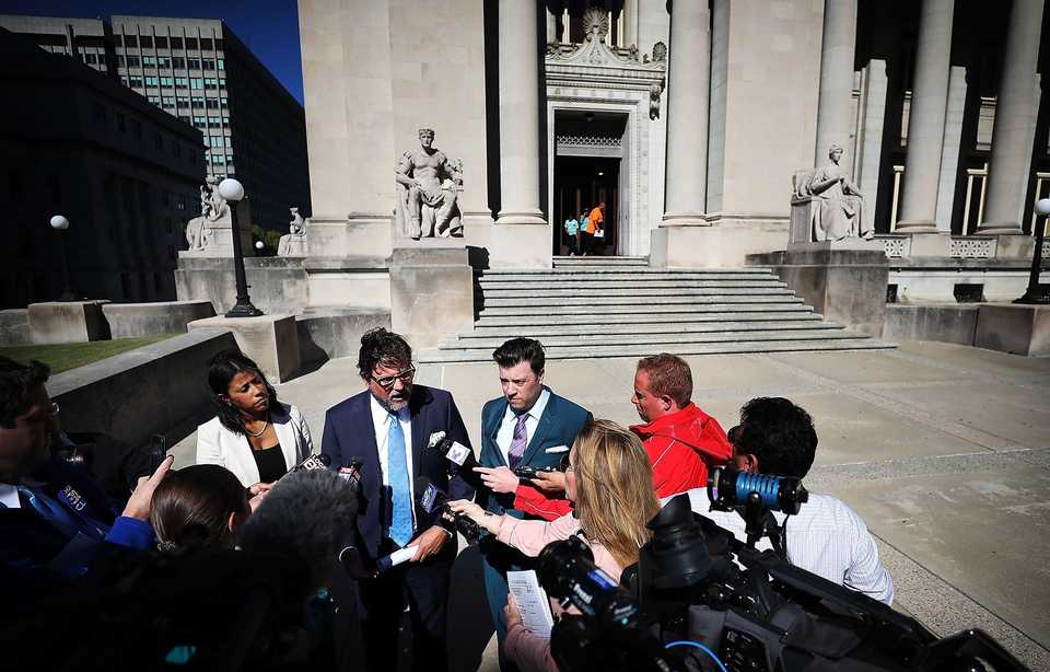 <strong>Attorneys Murray Wells (center) and Aaron Neglia (right) talk to the media on Thursday, Oct. 11, at the Shelby County Courthouse about a lawsuit filed against the city of Memphis and Police Director Michael Rallings on behalf of the family of Bardomiano Perez Hernandez, whose body was found in the back of a van at the police impound lot.</strong><span>&nbsp;(Jim Weber/Daily Memphian)</span>