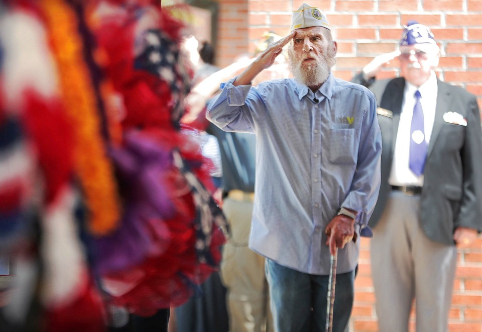 "<strong>John Burkhart, 66, who spent 22 years in the military, salutes during ""Amazing Grace"" at the annual Memorial Day ceremony at the West Tennessee State Veterans Cemetery on Monday, May 27.</strong> (Jim Weber/Daily Memphian)"