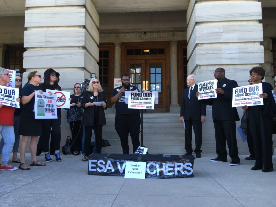 <strong>Public education advocates rallied against an education savings account bill in Tennessee at the state Capitol in Nashville on April 22, 2019.&nbsp;State Rep. Joe Towns believes the governor should rescind the signing of the voucher bill into law and have it heard again by the Legislature in the wake of a racist and sexist texting scandal surrounding House Speaker Glen Casada, who pushed the bill through the House.&nbsp;</strong>(Jonathan Mattise/Associated Press file)