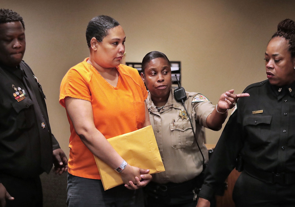 <strong>Sherra Wright is led into court during a hearing before Criminal Court Judge Lee Coffee on Thursday, May 30.</strong>&nbsp;<strong>Coffee ruled that Wright's phone calls and texts can be used in her trial on charges that she murdered her ex-husband, former NBA player Lorenzen Wright.&nbsp;</strong>(Jim Weber/Daily Memphian)