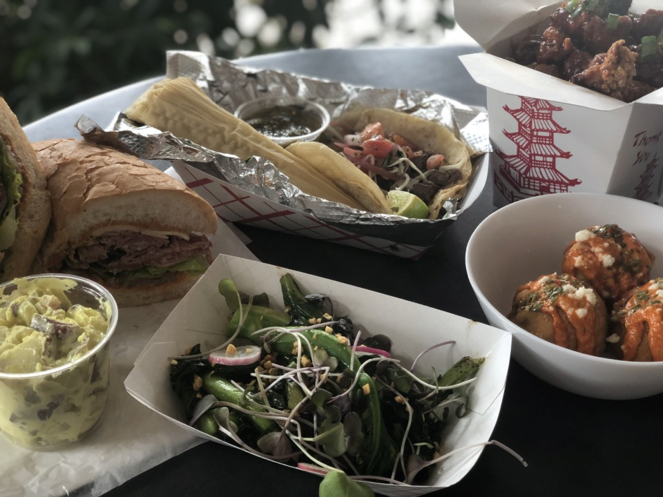 <strong>Puck Food Hall dishes include The Spicy Italian from City Block, Chinese broccoli and General Tso's Chicken from Wok'n in Memphis and tamales, a vampiro and molotes from Venga.</strong> (Jennifer Biggs/Daily Memphian)