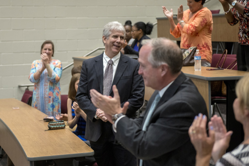 <strong>Gary Lilly (center) acknowledges the applause after being named new superintendent of Collierville Schools during a special meeting at Collierville High School on May 30, 2019.</strong> (Brandon Dill/Special To The Daily Memphian)