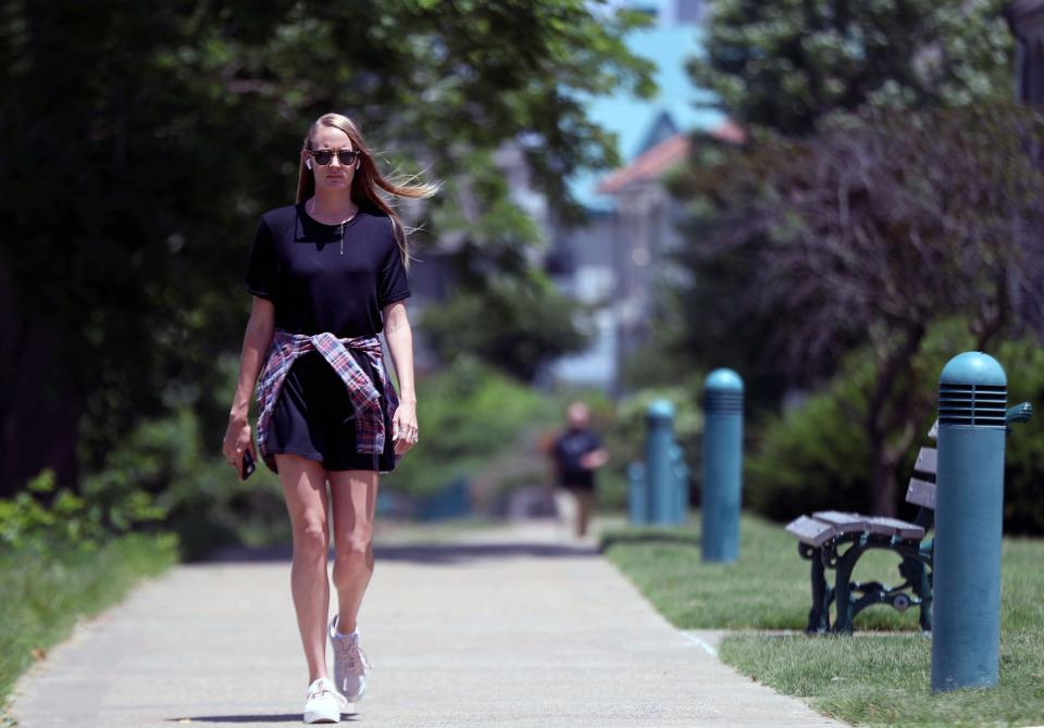 <strong>Abbie Gordon enjoys her daily walk along the Bluff near Butler Park on Friday, May 31, 2019.</strong> (Patrick Lantrip/Daily Memphian)