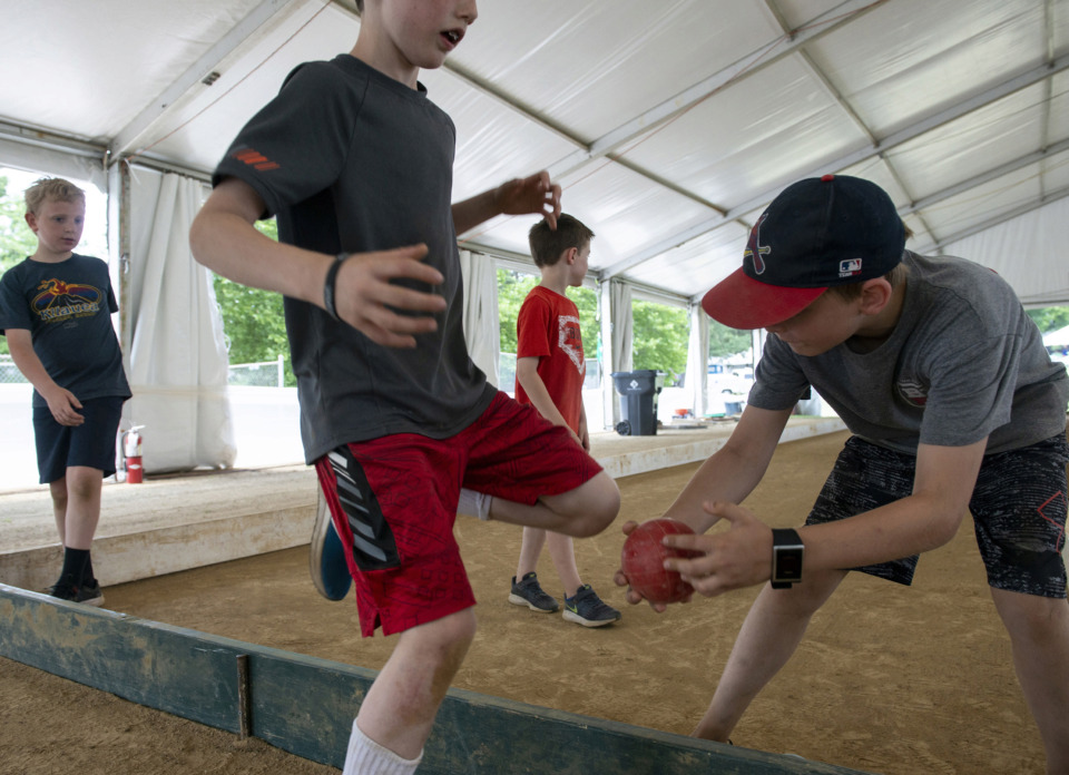<strong>Charlie Ogg, 8 (from left); Ben Kovacs, 5; Joseph Lobonte, 8; and Thomas Kovacs, 8, play bocce ball during the 30th annual Memphis Italian Festival at Marquette Park on May 30, 2019, in Memphis.</strong> (Brandon Dill/Special To The Daily Memphian)