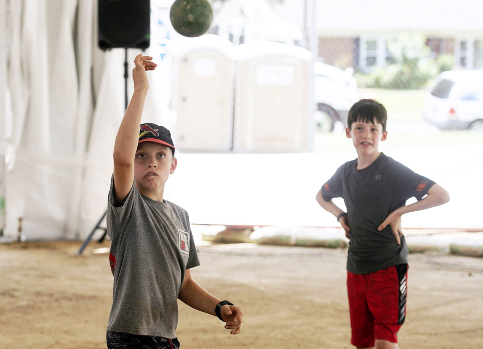 <strong>Joseph Lobante, 8, makes a throw while Thomas Kovacs, 8, looks on as the friends play bocce ball during the 30th annual Memphis Italian Festival at Marquette Park on May 30, 2019, in Memphis.</strong> (Brandon Dill/Special To The Daily Memphian)