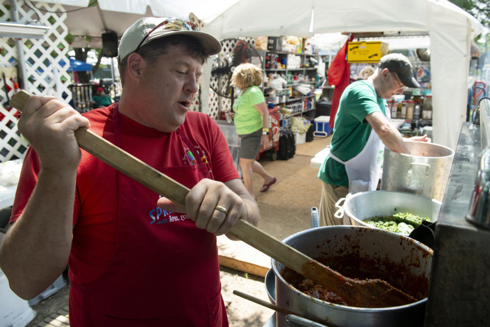 "<strong>""Oliveus"" members Scott Brown (left) and Steve Landwehr work on their team's Italian gravy sauce for competition during the 30th annual Memphis Italian Festival at Marquette Park on May 30, 2019, in Memphis.</strong> (Brandon Dill/Special To The Daily Memphian)"