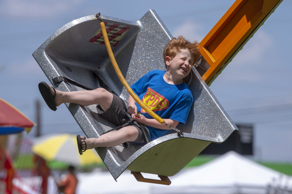 "<strong>Jasper Burch, 7, takes a spin on the ""Ballistic"" ride during the 30th annual Memphis Italian Festival at Marquette Park on May 30, 2019, in Memphis.</strong> (Brandon Dill/Special To The Daily Memphian)"