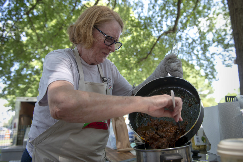 "<strong>""Thursday Night Italians"" team member Mary Wilder works on the spaghetti gravy her group will enter into competition during the 30th annual Memphis Italian Festival at Marquette Park on May 30, 2019, in Memphis.</strong> (Brandon Dill/Special To The Daily Memphian)"