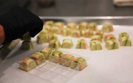 "<strong>Rebecca Hartman told Phillip Ashley Rix she wanted ""something sort of tropical but sort of wedding cake, too."" Her white chocolate candy, The Hartman, has </strong><strong>lime-, coconut- and vanilla bean-flavored filling, and will be sold at Phillip Ashley Chocolates through the next few months.</strong> (Patrick Lantrip/Daily Memphian)"