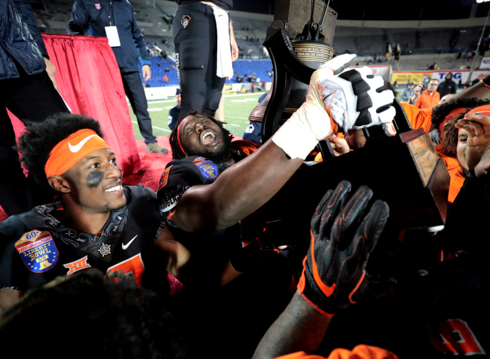 <strong>Oklahoma State Cowboys offensive lineman Deionte Noel (68) celebrates after winning the Liberty Bowl against the University of Missouri Tigers on Dec. 31, 2018, at Liberty Bowl Memorial Stadium in Memphis. The Liberty Bowl has renewed its sponsorship agreement with AutoZone and will continue SEC and Big 12 affiliations.&nbsp;</strong>(The Daily Memphian file)