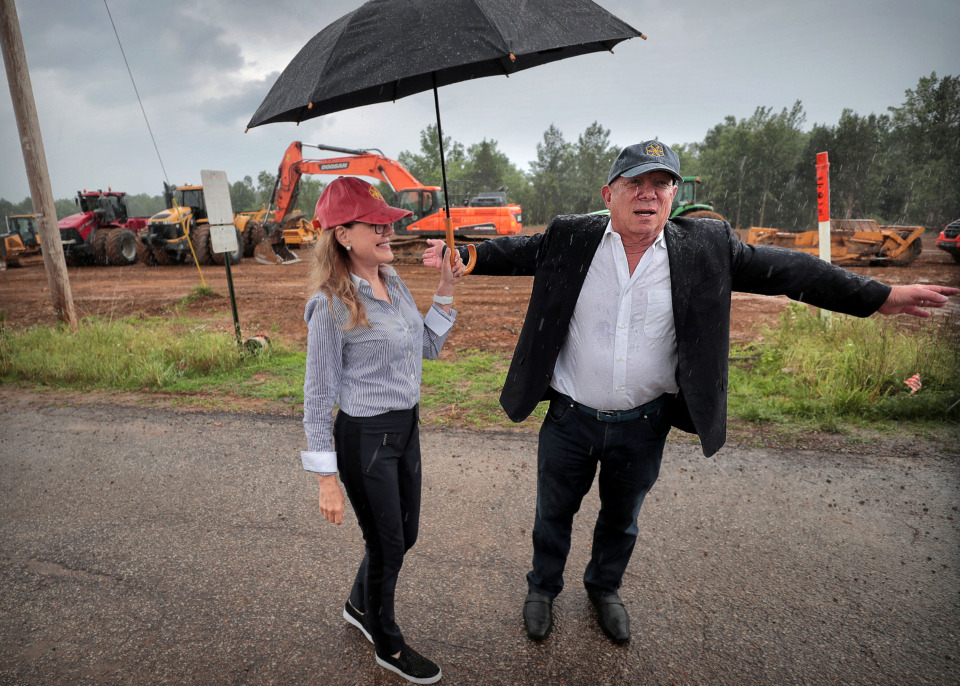 "<strong>""Phase 1 of The Lake District is rolling,"" said Yehuda Netanel (right), president of Gilad Development, developer of The Lake District, a 165-acre development in Lakeland. Maggie Gallagher, Gilad's development director, shields Netanel from the rain during a press conference Tuesday at the construction site.&nbsp;</strong>(Jim Weber/Daily Memphian)"