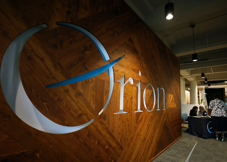 <strong>Aparna Basu and Courtney Griesenauer check people in for reception in Orion Federal Credit Union&rsquo;s new Monroe Avenue headquarters Tuesday, June 4, 2019. Orion leaders say they moved to the Edge District&nbsp;because it had been an economically distressed commercial area sandwiched between Downtown and the Medical District.</strong> (Patrick Lantrip/Daily Memphian)
