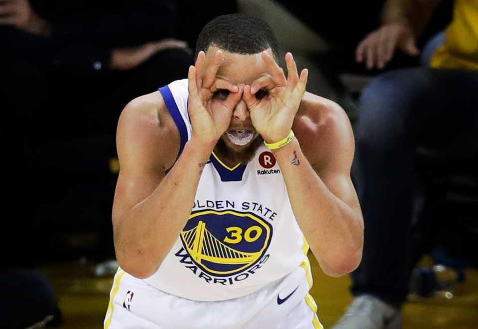 <strong>Golden State Warriors guard Stephen Curry (30) celebrates during overtime of Game 1 of the NBA Finals between the Warriors and the Cleveland Cavaliers in Oakland, Calif., on May 31, 2018.</strong> (AP Photo/Marcio Jose Sanchez)