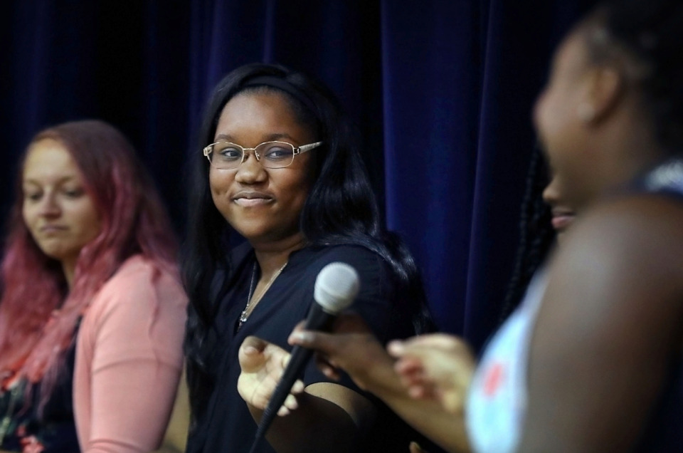 <strong>Destiny Dangerfield, who will be attending Vanderbilt University in the fall, passes the mic during a student-led panel discussion at Bruce Elementary on Wednesday, June 5, 2019. The panel was designed to offer advice to first time Teach for America teachers.</strong> (Patrick Lantrip/Daily Memphian)