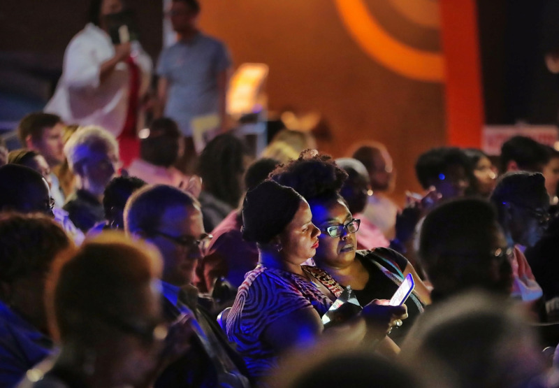 <strong>Residents divided by City Council districts use their cell phones to vote during the People's Convention on June 8, 2019, at the Paradise Entertainment Center as politicians, activists and engaged voters gather to select a slate of candidates in the local October elections.</strong> (Jim Weber/Daily Memphian)