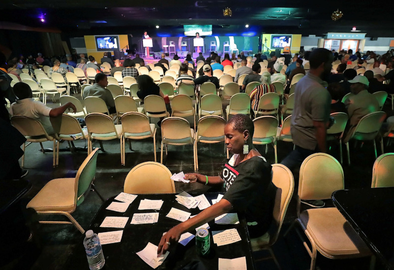 <strong>Volunteer Regina Clarke sorts through questions for the candidates during the People's Convention on June 8, 2019, at the Paradise Entertainment Center.</strong> (Jim Weber/Daily Memphian)