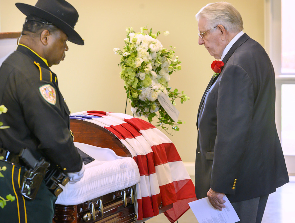 "<strong>Former Shelby County mayor William Morris pays respects to his longtime friend Roy ""Skip"" Nixon at St. Patrick Presbyterian Church in Collierville on Saturday, June 8. Nixon, who died on June 2, was the Shelby County sheriff after Bill Morris and then became the first Shelby County mayor.</strong> (Greg Campbell/Special to the Daily Memphian)"