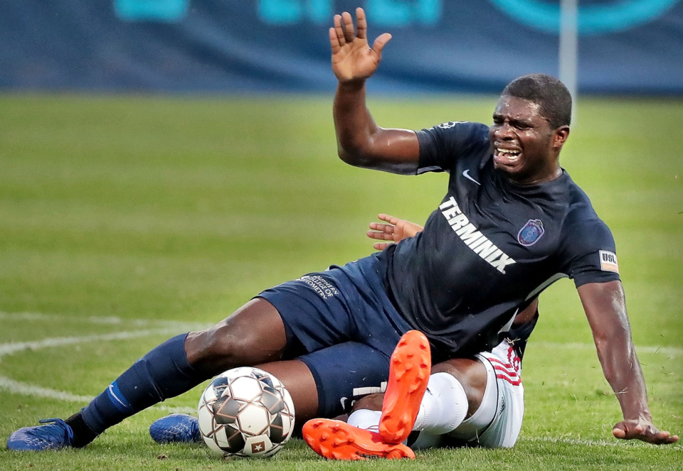 <strong>Memphis midfielder Ewan Grandison collides with Indy Eleven defender Dane Kelly during Memphis 901 FC's 3-0 loss to Indianapolis at AutoZone Park on June 8, 2019.</strong> (Jim Weber/Daily Memphian)