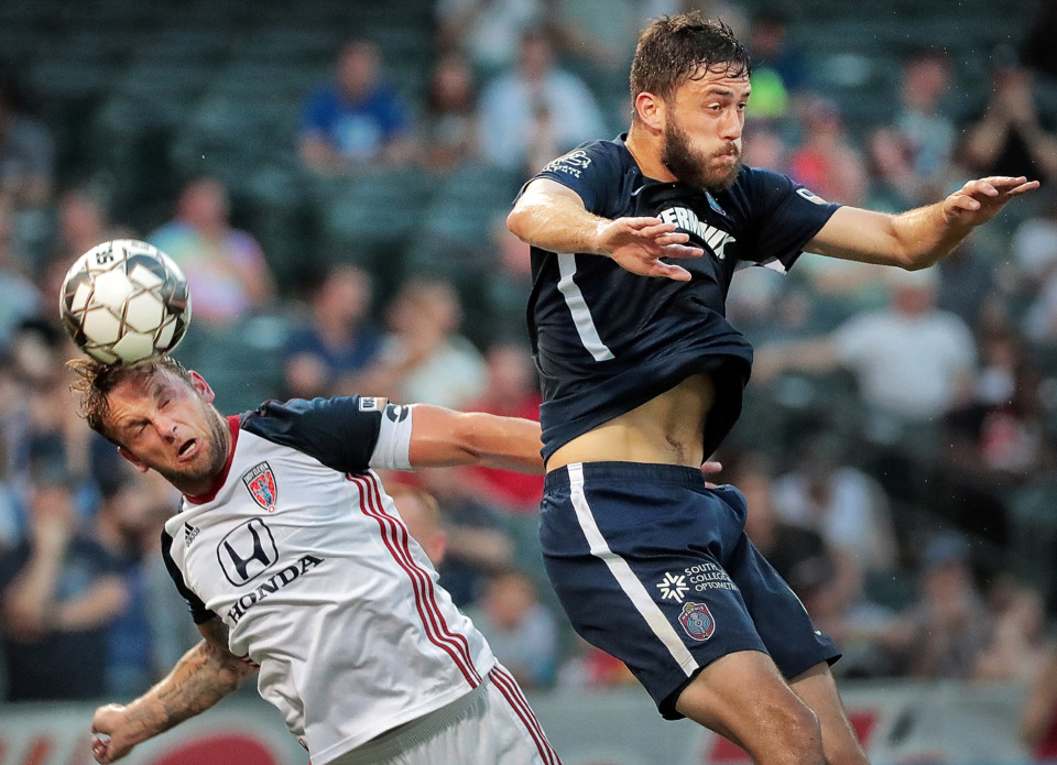 <strong>Memphis forward Elliot Collier (right) misses a header against Indy Eleven defender Paddy Barrett during Memphis 901 FC's 3-0 loss to Indianapolis at AutoZone Park on June 8, 2019.</strong> (Jim Weber/Daily Memphian)