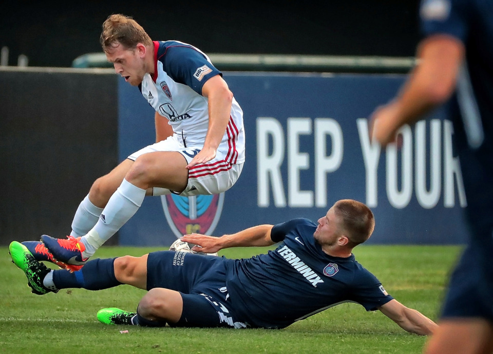 <strong>Memphis defender Josh Morton slide tackles Indy Eleven forward Macauley King during 901 FC's 3-0 loss to Indianapolis at AutoZone Park on June 8, 2019.</strong> (Jim Weber/Daily Memphian)