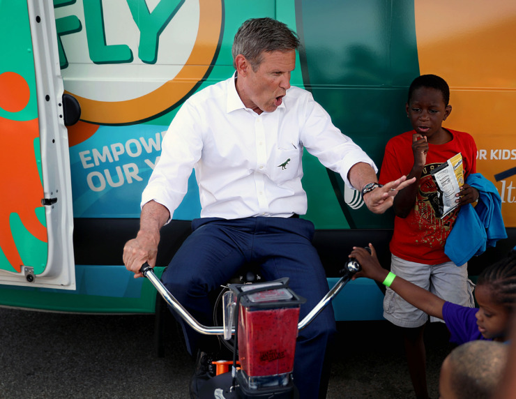 <strong>Gov. Bill Lee blends a bicycle-powered smoothie during a visit to a&nbsp;<span>YMCA mobile area called &ldquo;Y on the Fly&rdquo; </span>at the Greenbriar Apartments Tuesday, June 11.</strong>&nbsp;(Patrick Lantrip/Daily Memphian)