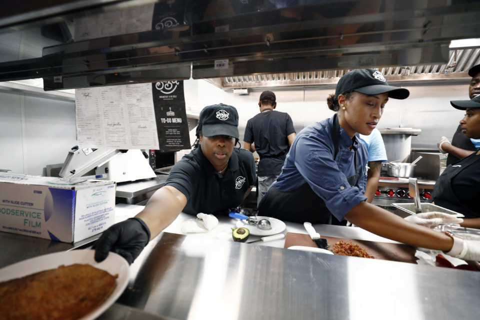 <strong>Laquetha Thomas (left) and lead cook Cammy Henry prepare breakfast items while training at the soon-to-open The Bagel restaurant in East Memphis, June 10, 2019.</strong> (Mark Weber/Daily Memphian)