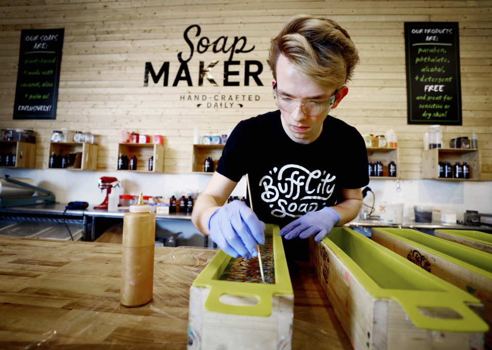 <strong>Elijah Bienz, a soap maker at Buff City Soap, makes a batch of Sa-Shea Away! soap in Buff City's Bartlett location on Tuesday, June 11.</strong> (Mark Weber/Daily Memphian)