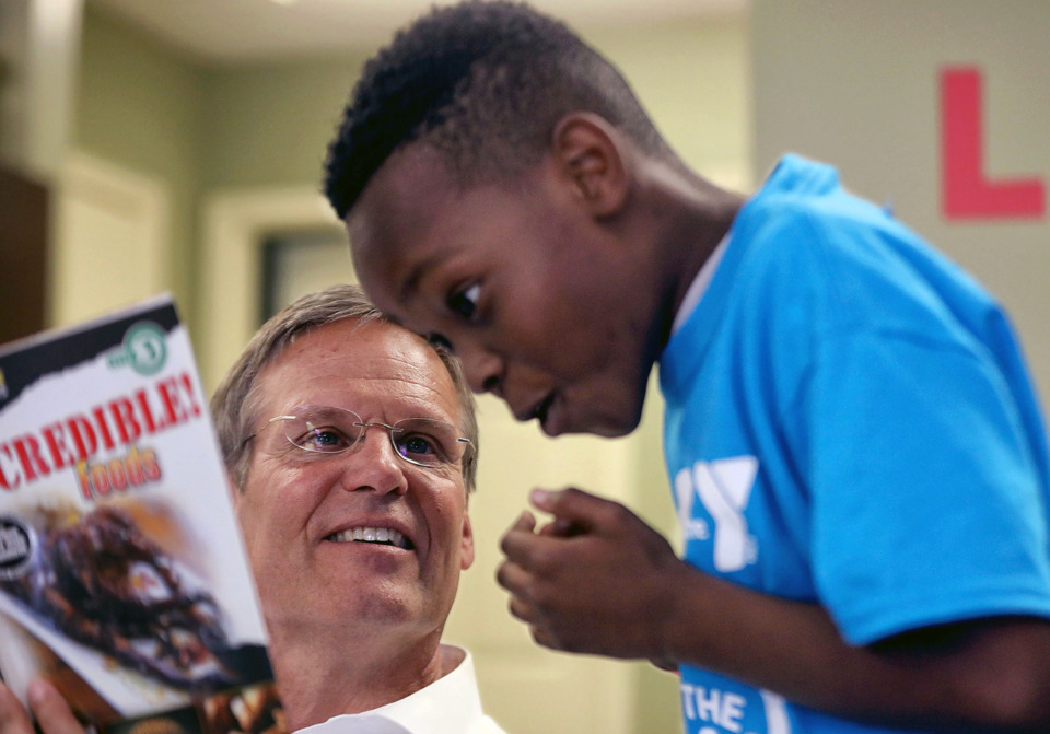 <strong>Tennessee Gov. Bill Lee reads to a child at Greenbriar Apartments in Frayser while in Memphis on Tuesday, June 11, 2019.&nbsp;Lee says he's disappointed a federal grant that has funded Read to be Ready camps the last two summers could not be used for that purpose this year.&nbsp;</strong>(Patrick Lantrip/Daily Memphian)