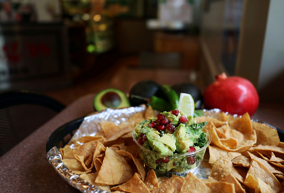 <strong>Jonathan Magallanes uses pomegranate seeds in place of tomatoes in a fresh new guacamole at Las Tortugas.</strong> (Patrick Lantrip/Daily Memphian)