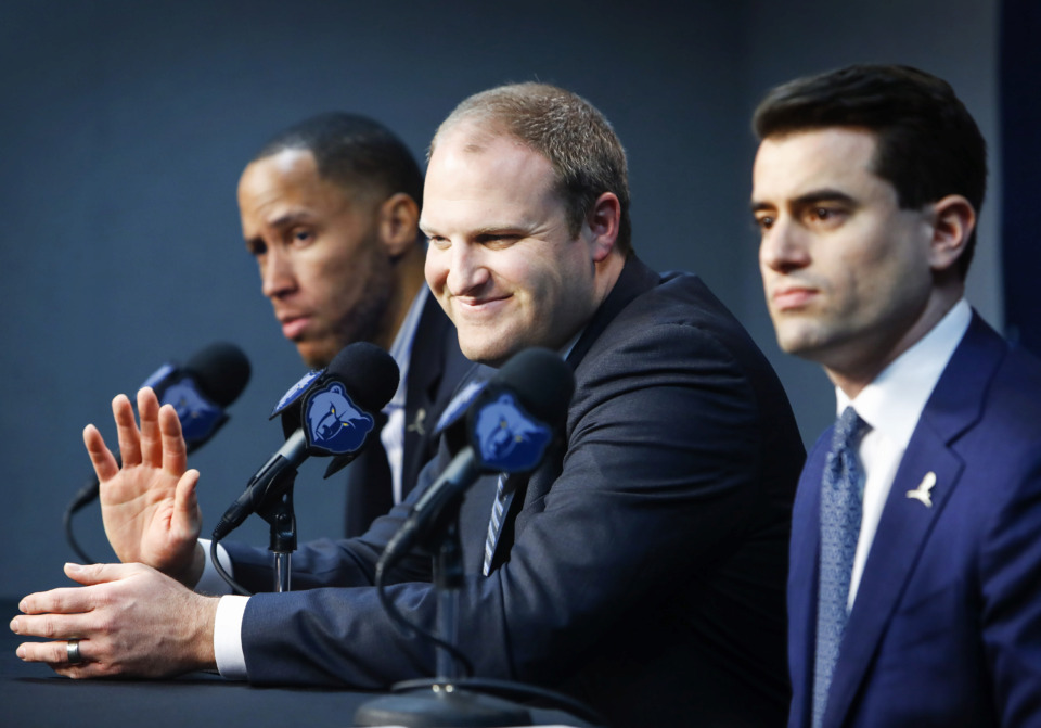 <strong>Taylor Jenkins (middle) waves to his family after being introduced as the Memphis Grizzlies' new head coach during a press conference at FedExForum Wednesday, June 12, 2019.</strong> (Mark Weber/Daily Memphian)