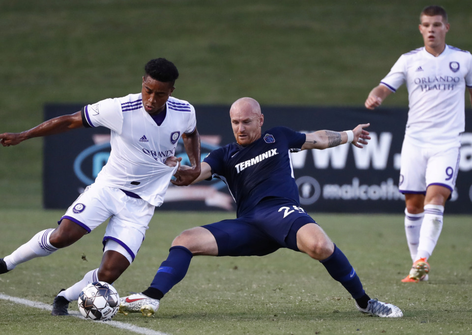 <strong>Memphis 901 FC forward Jochen Graf (right) battles Orlando City SC midfielder Cristian Higuita (left) during fourth-round action of the Lamar Hunt U.S. Open Cup at the Mike Rose Soccer Complex Wednesday, June 12, 2019.</strong> (Mark Weber/Daily Memphian)
