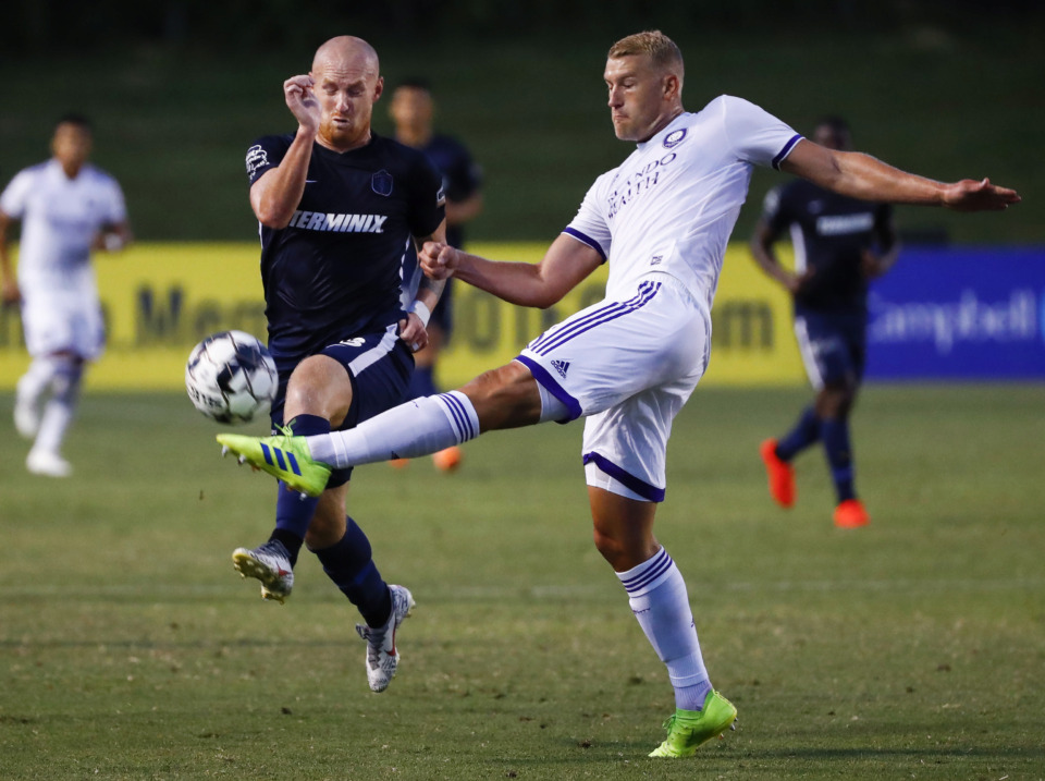 <strong>Memphis 901 FC forward Jochen Graf (left) battles Orlando City SC defender Robin Jansson (right) for a loose ball during fourth-round action of the Lamar Hunt U.S. Open Cup at the Mike Rose Soccer Complex Wednesday, June 12, 2019. Memphis fell 3-1 to the MLS team.</strong> (Mark Weber/Daily Memphian)