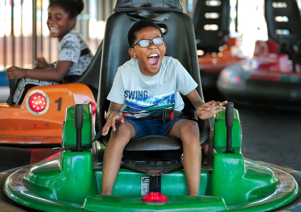 <strong>Rashaun Haynes, 9, gets bumped by Jarquez Onidas, 9, during a Boys and Girls Club trip to the Golf and Games Family Park on Summer Avenue. The amusement center has released several new attractions over the last year, including expansions to its laser tag arena, virtual reality games, a Spin Zone ride and golf ball tracking on the driving range.</strong> (Jim Weber/Daily Memphian)
