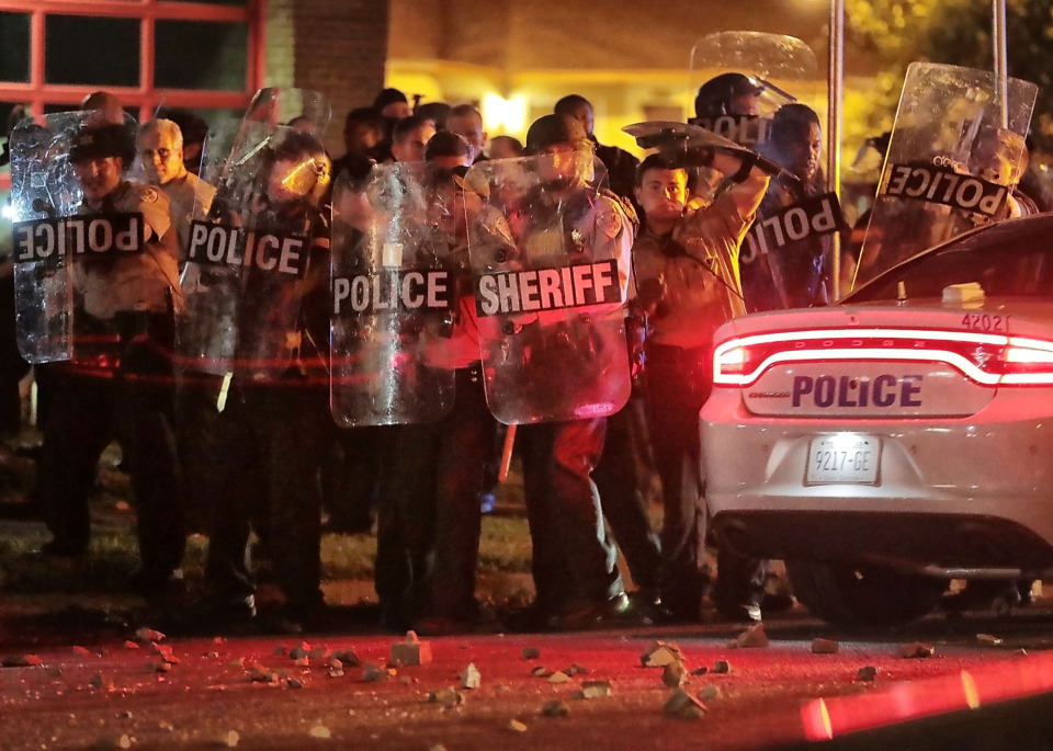 "<strong>Shelby County Sheriff's Department deputies brace against the crowd as protesters take to the streets of Frayser in anger against the shooting of a youth identified by family members as Brandon Webber by U.S. Marshals earlier Wednesday evening.&nbsp;</strong><span class=""s1""><strong>Dozens of protesters clashed with police, throwing stones and tree limbs until police forces broke up the angry crowd with tear gas. </strong>(Jim Weber/Daily Memphian)</span>"