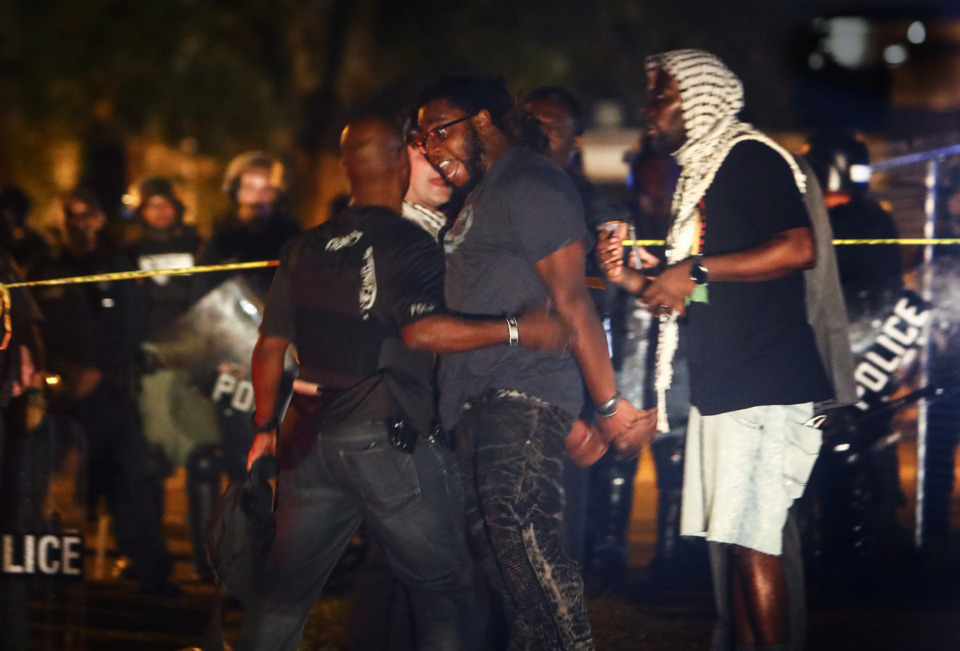 <strong>Protesters take to the streets of Frayser in anger against the shooting of a youth identified by family members as Brandon Webber by U.S. Marshals earlier in the evening. Dozens of protesters clashed with police, throwing stones and tree limbs until police forces broke up the angry crowd with tear gas.</strong> (Mark Weber/Daily Memphian)