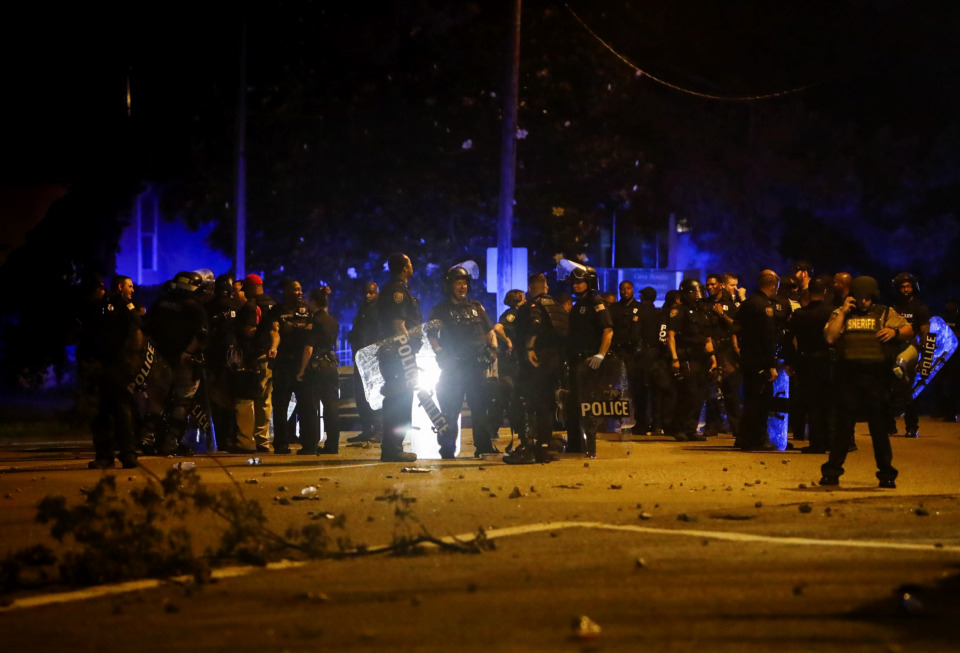 "<strong>Memphis police maintain a perimeter around the crime scene after protesters took to the streets of Frayser in anger over the shooting a youth earlier Wednesday.&nbsp;</strong><span class=""s1""><strong>Dozens of protesters clashed with police, throwing stones and tree limbs until police forces broke up the angry crowd with tear gas.</strong> (Jim Weber/Daily Memphian)</span>"