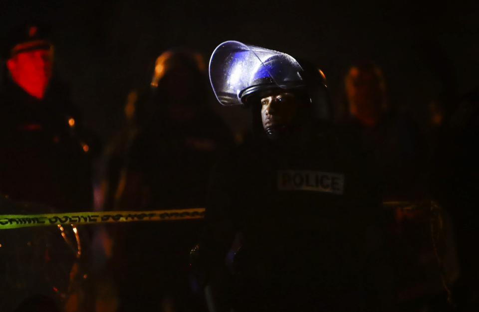 <strong>Memphis police maintain a perimeter around the crime scene after protesters took to the streets of Frayser in anger over the shooting of a youth by U.S. Marshals earlier Wednesday. Dozens of protesters clashed with police, throwing stones and tree limbs until police forces broke up the angry crowd with tear gas.</strong>(Mark Weber/Daily Memphian)