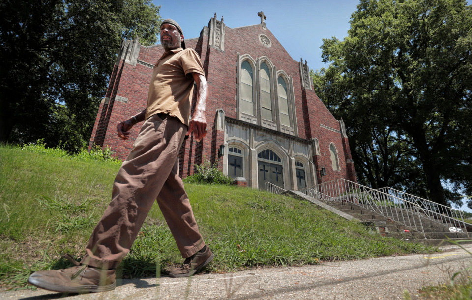 <strong>R.J. Haynes passes by the Highland Heights United Methodist Church on Summer Ave. which will hold its final service on Sunday, June 16, after worshipping at the same corner for 106 years.</strong> (Jim Weber/Daily Memphian)