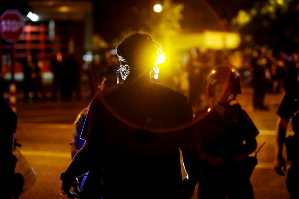 <strong>Protesters take to the streets of Frayser in anger over the shooting of a youth by U.S. Marshals earlier Wednesday. Dozens of protesters clashed with law enforcement, throwing stones and tree limbs until police broke up the angry crowd with tear gas.</strong> (Mark Weber/Daily Memphian)