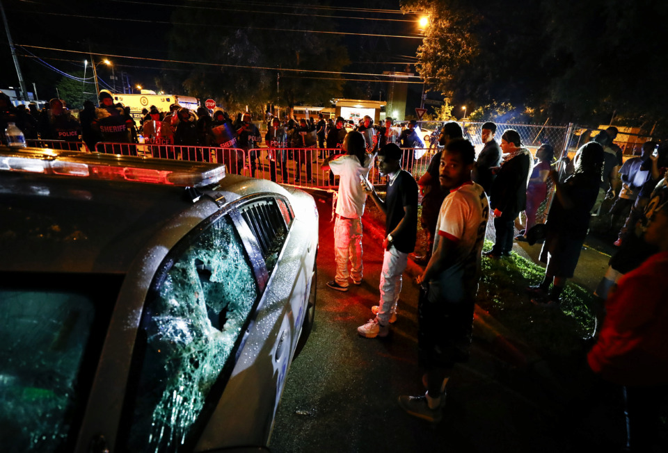 <strong>Protesters take to the streets of Frayser in anger against the shooting a youth by U.S. Marshals earlier Wednesday. Dozens of protesters clashed with law enforcement officials, throwing stones and tree limbs until police broke up the angry crowd with tear gas.</strong> (Mark Weber/Daily Memphian)
